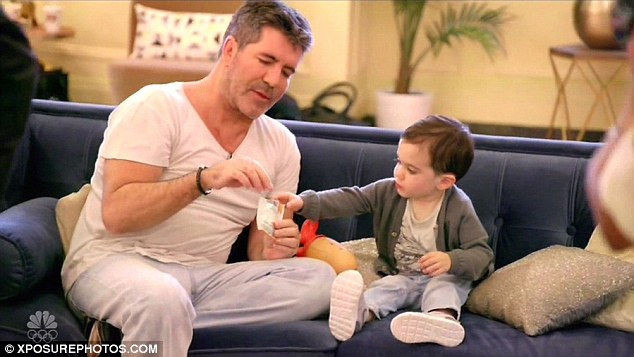 Doting father: The 56-year-old music mogul is attempting to cut down over concerns that two-year-old Eric will disapprove as he gets older