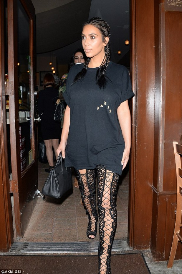 Fancy footwear: Kim Kardashian stepped out in sexy lace-up thigh high boots on Thursday, enjoying a meal atIl Pastaio in Beverly Hills