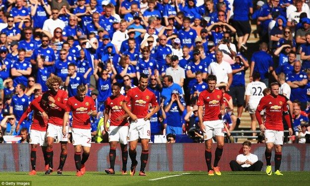 Fellaini (second left) puts his arm around Lingard in celebration after the forward scored the opener