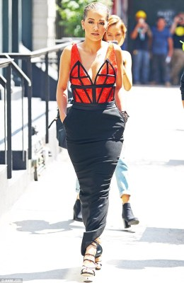 Funky fashion:However despite the error, Rita still managed to turn heads thanks to her stylish flair, wowing in a slinky orange and black dress