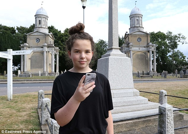Libby Connor at the pokestop in Mistley: Locals have also contacted the game's developers to request the 'Pokestops' - where players gather to catch Pokemon - are removed