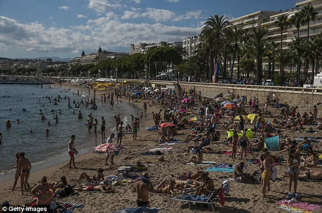 Women will not be allowed to wear the swimsuits on the beaches of Cannes ( pictured, the glamorous French resort)