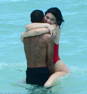 Loved up! The teen appeared to be having a whale of a time, as she wrapped her legs around beau Tyga in the sea, beaming widely