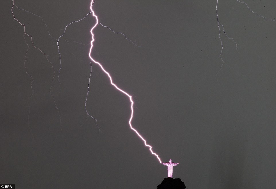 Lightning strikes next to the statue Christ the Redeemer in Rio de Janeiro, Brazil, on January 16, 2014
