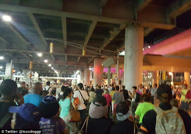 Pictures posted on social media showed huge crowds of people evacuating the terminal