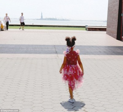 Pretty in pink: The never-before-seen family snaps Bey posted on her website on Thursday show her daughter against the backdrop of the Statue Of Liberty in the distance