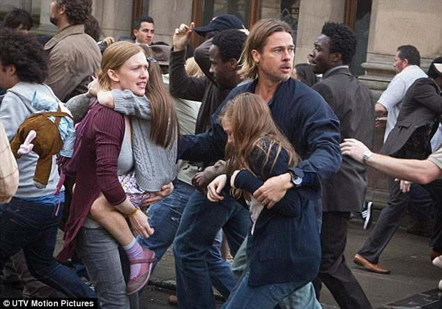 The original source of the zombie outbreak is rarely a concern in horror films, whereas epidemiologists spend a lot of time using analysis and models to track back to the first case of disease. Pictured is a scene from the zombie film World War Z which stars Brad Pitt