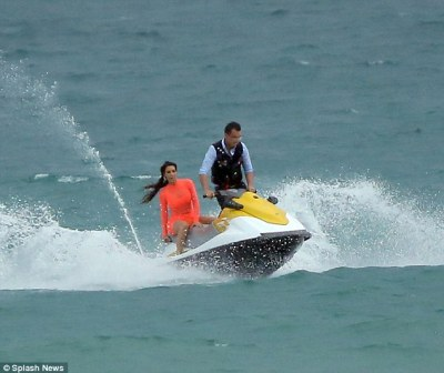 Daredevil: Kim didn't bother using her life jacket as she hopped on the back of a jet ski