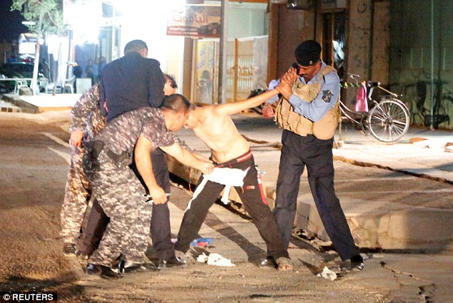 Detained: In August footage emerged (pictured) of Mohammed Ahmed Ismail's attempted suicide bombing of a stadium being thwarted by the Iraqi security forces