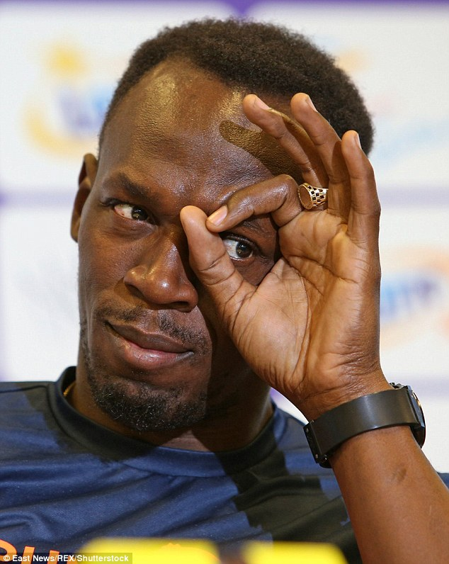 Sign of the beast: Curling the thumb to meet the index finger might be construed as a cryptic message, say some of those analysing Bolt's moves