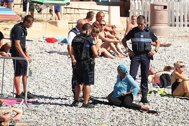 The woman, who was wearing a traditional headscarf and matching top, was spoken to by the officers, who have been tasked with implementing the ban. France prides itself on its secular society and the burka is banned. That has now spread to the burkini