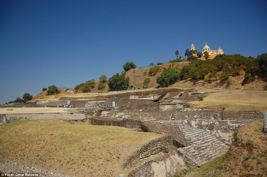 In 1519, Hernan Cortez and his men marched into the great Aztec city of Cholulu, massacred 10 percent of the population and built a tiny church on top of a massive hill as a symbol of their conquest. However, hiding under the tufts of grass, trees and soil of this hill was the Great Pyramid of Cholula, which has a base four times the size of the Great Pyramid and is deemed the largest monument ever built on Earth