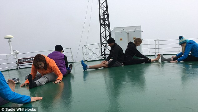 Arctic gales: The yogis kept bundled up as they took to the outer deck