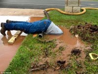 Texas utility worker fixing a leaking pipe sweeps the ...