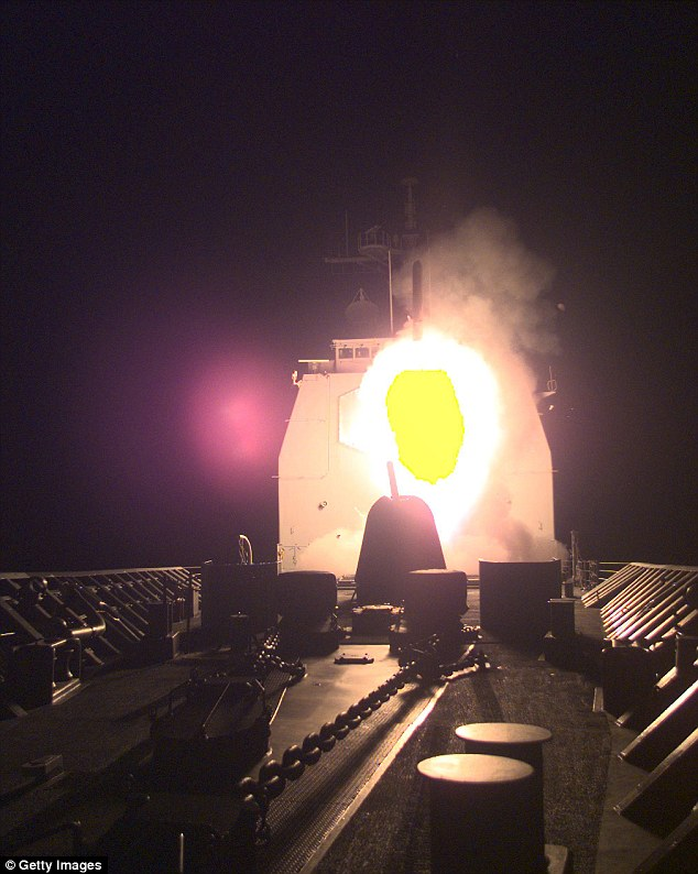 Strike: An Arleigh Burke-class destroyer launches a Tomahawk cruise missile as part of Operation Desert Fox - which Abedin's journal says was ordered to distract from Bill Clinton's scandals