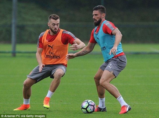 Calum Chambers (left) competes with Olivier Giroud in Arsenal training last Friday