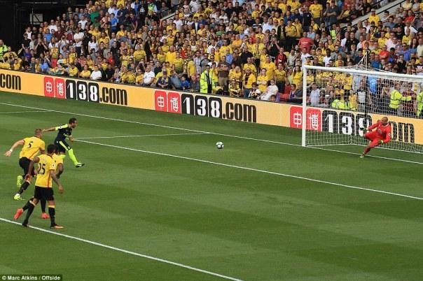 The 31-year-old watches on as his spot-kick beats Watford goalkeeper Heurelho Gomes