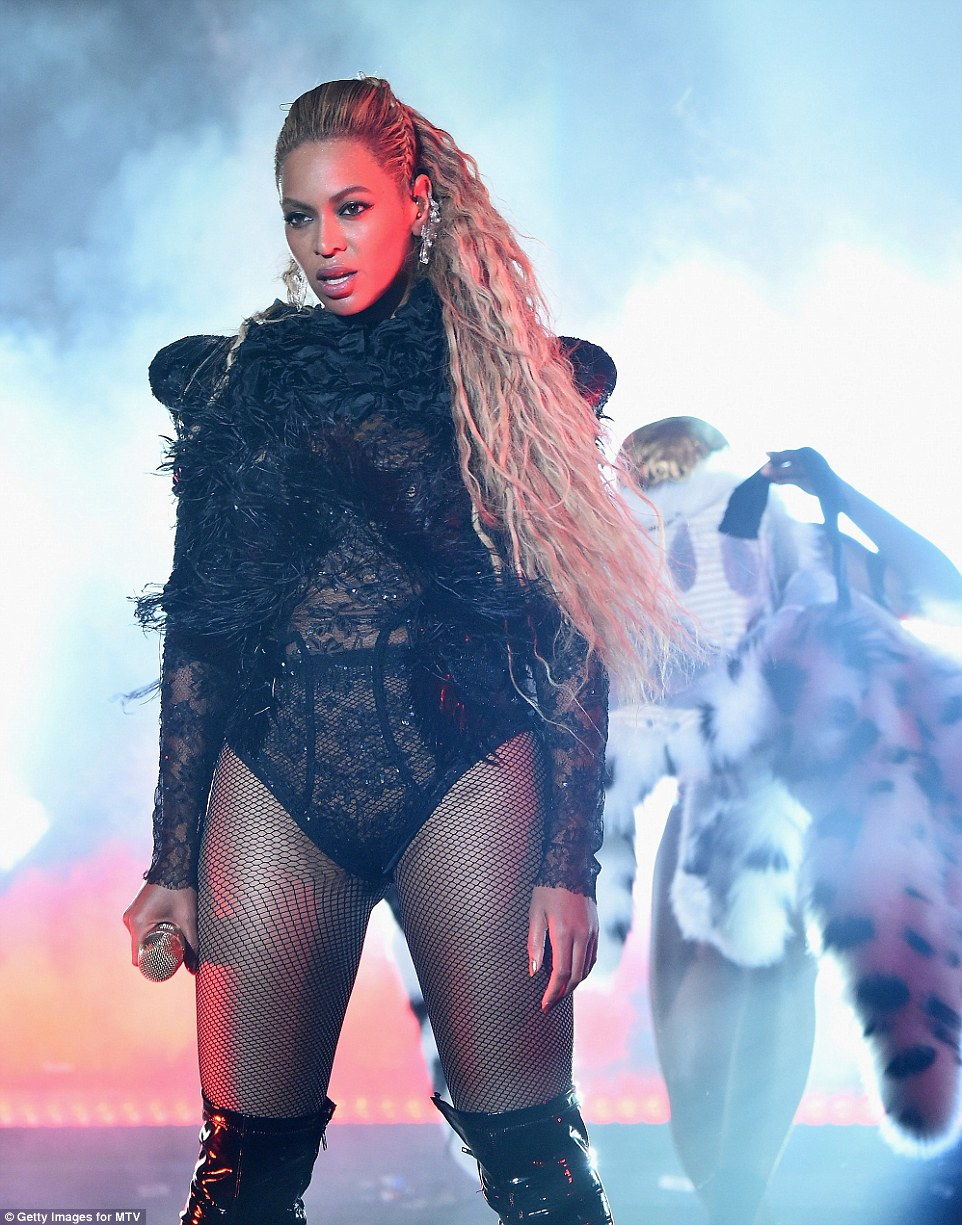 Wow factor: She then reveals a lacy black bodysuit with fishnets