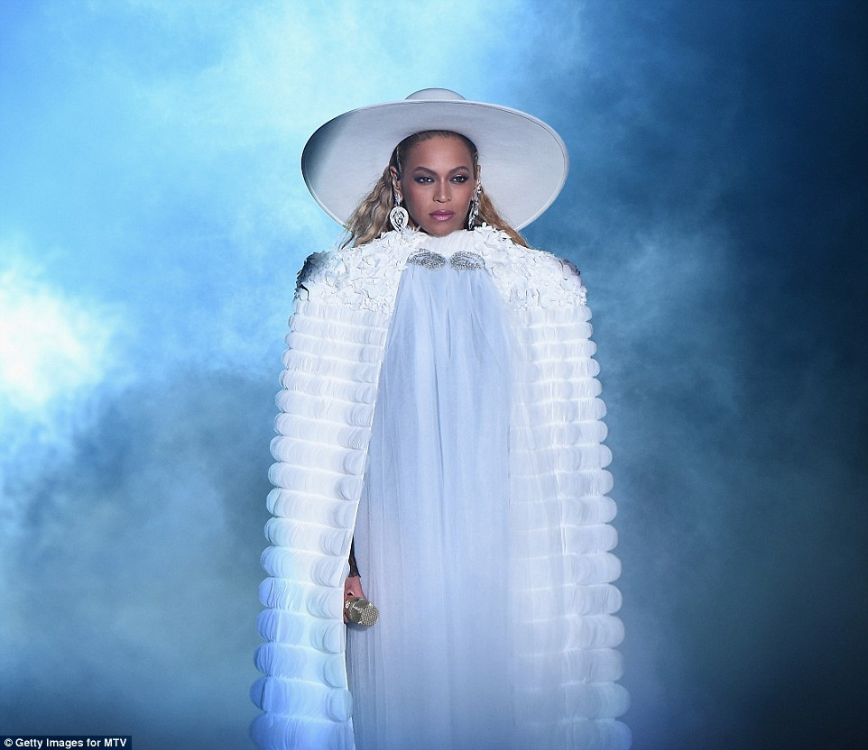Wonder in white: The singer begins her performance wearing a white cloak and matching large hat