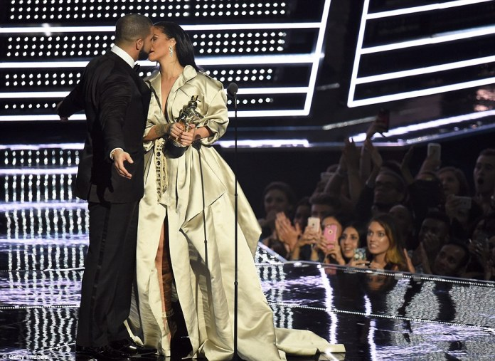 TLC: As Rihanna gave him a peck on the cheek, Drake continued to lean in to kiss her on the neck