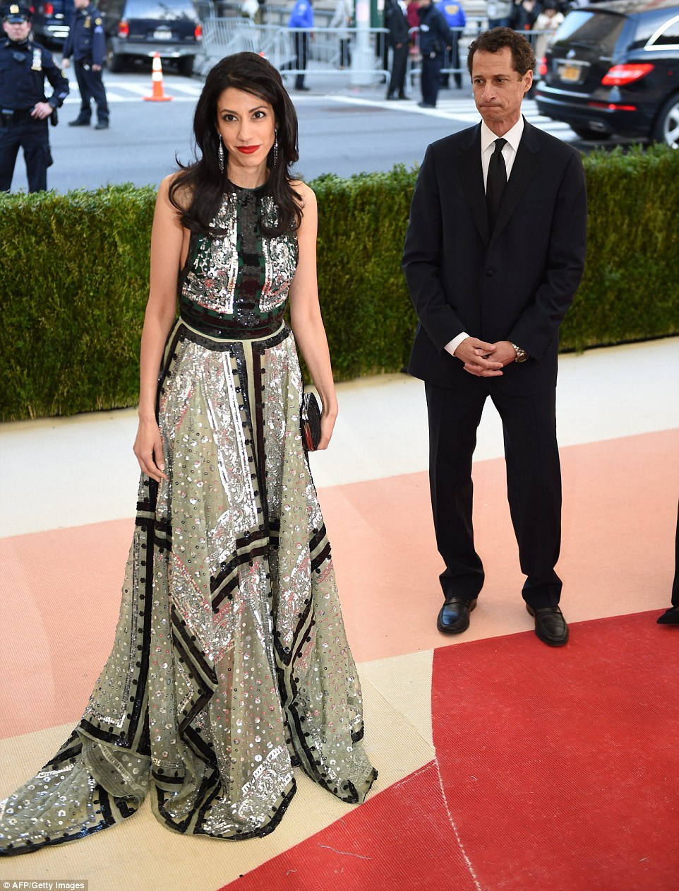 End of the road:Huma Abedin has revealed in a statement that she is separating from her husband Anthony Weiner in the wake of his latest sexting scandal (couple above in May at the Met ball)
