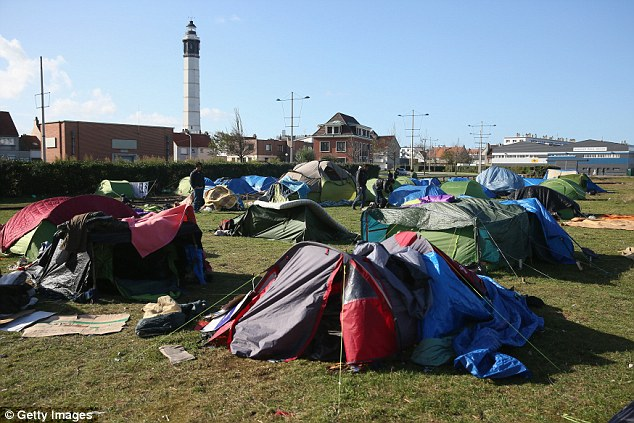 An encampment of makeshift tents, home to migrants of mainly Syrian origin, near to the Calais ferry port in 2013