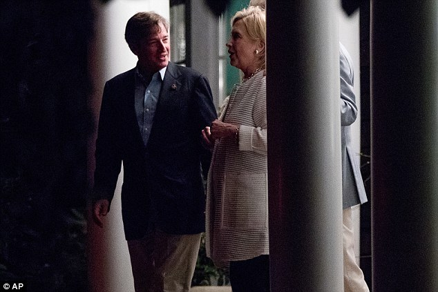 Clinton (right) was later seen with Democratic Party activist Jay Snyder (left)  after a fundraiser at his home in East Hampton on Monday
