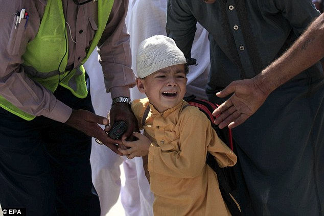 A school boy cries following a bomb blast targeting a Christian colony in the Khyber Pakhtunkhwa provincial capital of Peshawar