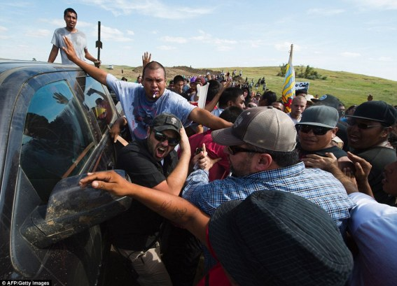Native American protesters and their supporters clash with security guards just outside the Standing Rock Sioux reservation