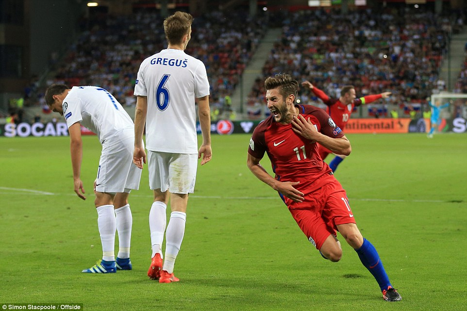 The Liverpool midfielder wheels away after his dramatic late goal at the City Arena gave England the three points