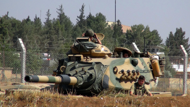 A Turkish army tank stationed near the Syrian border, in Suruc, Turkey, Saturday, Sept. 3, 2016. Turkey's state-run news agency says Turkish tanks have enter...