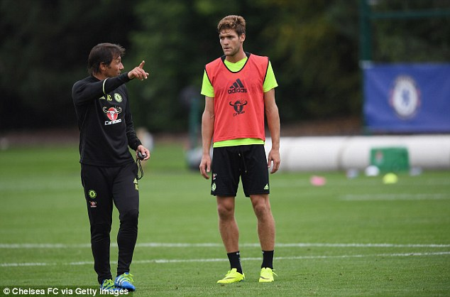 Manager Antonio Conte gets his point across to the defender at the Cobham training ground