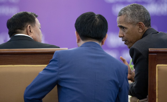 Laotian President Bounnhang Vorachit and U.S. President Barack Obama talk with the help of a translator during an Official State Luncheon at the Presidential...