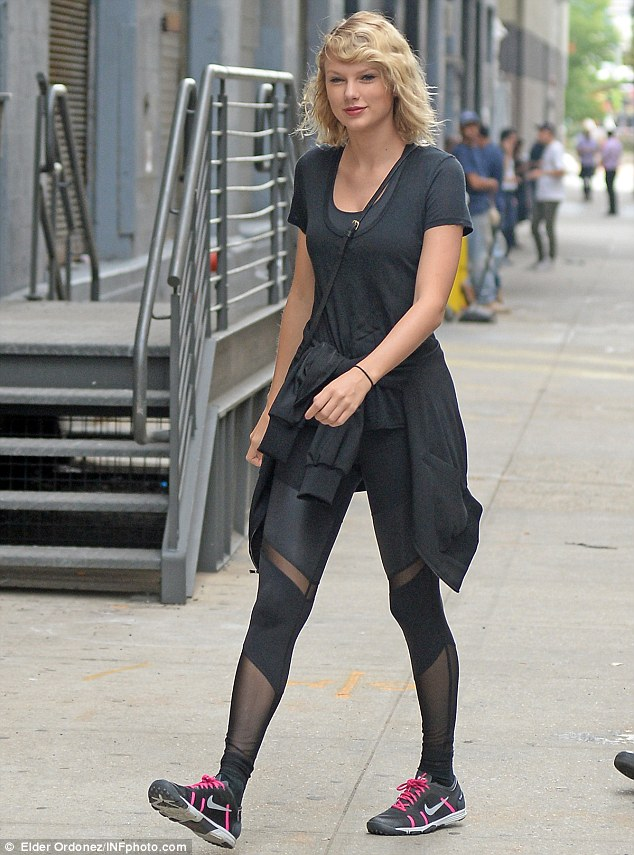Carefree: Taylor Swift headed to the gym in New York on Wednesday following her split from Tom Hiddleston after three months together