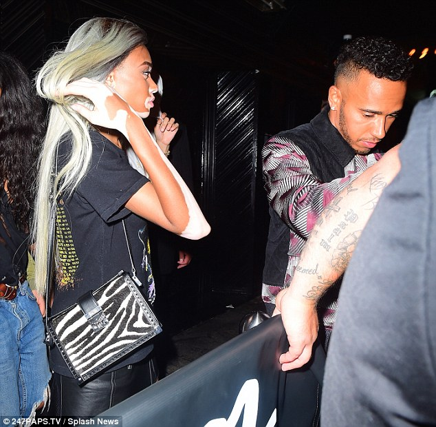 Side by side: Despite arriving separately, Lewis and Winnie were seen leaving the club together after partying with a group of friends