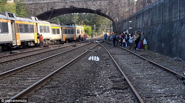 Authorities in Galicia said two people were killed, but the national rail company Renfe said 'several' people died in the train, which was carrying about 60 people