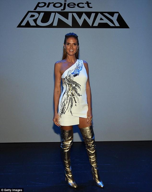 Heidi Klum Uses Thigh High Metal Boots And Eccentric