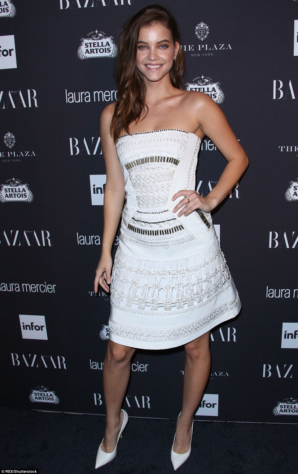 Model material: Hungarian model Barbara Palvin also headed to the star-studded bash, opting for the rare choice of a mini dress to show off her incredibly slender pins