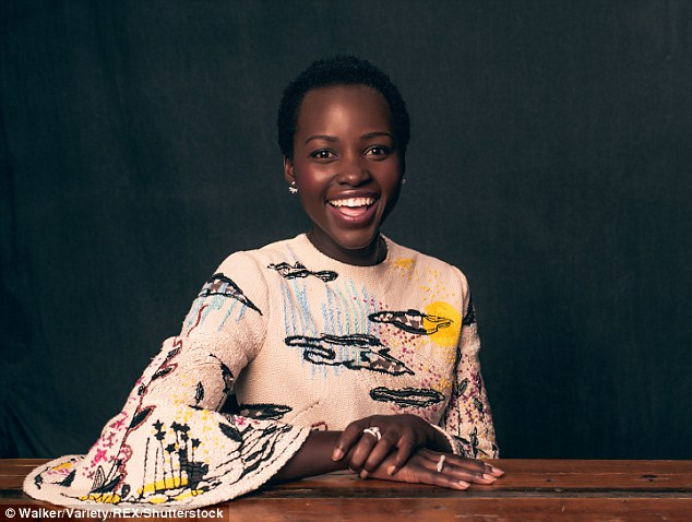 Good spirits: Lupita wowed in a unique, beautifully designed white dress