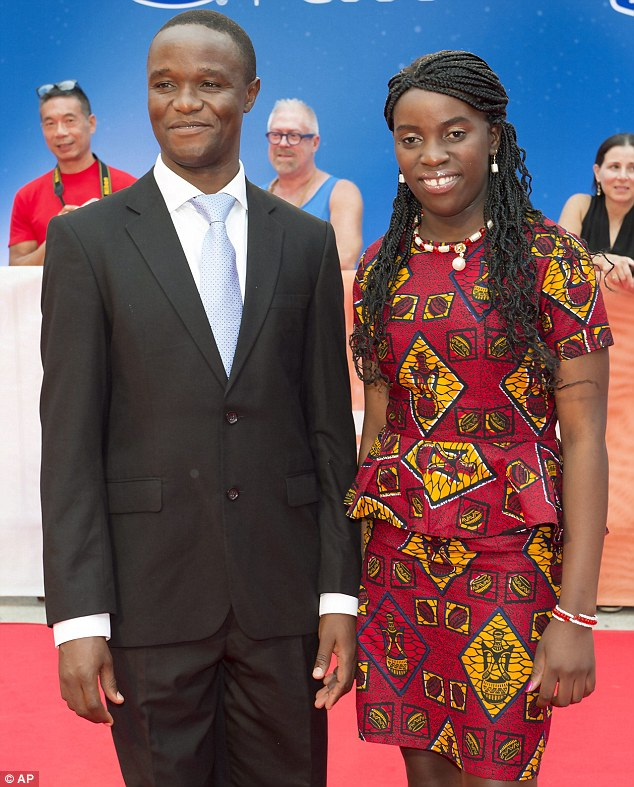 All smiles: Robert Katende posed with Phiona Mutesi - the real life champion who the movie is based on