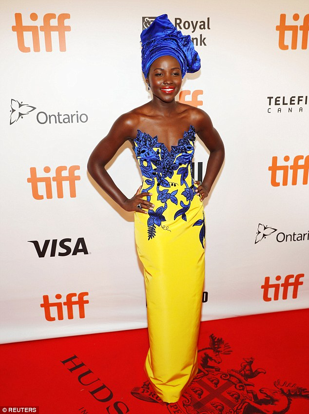A ray of sunshine: Lupita Nyong'o stepped out in an illuminating House of Herrera dress for the Queen of Katwe premiere at the 41st Toronto International Film Festival on Saturday