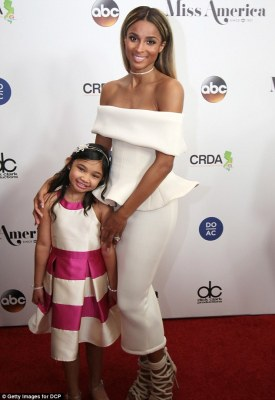 Confrères: She posed alongside her fellow singer, nine-year-old Angelica Hale