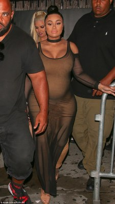 Hot mama: Cutting low into a round neck at the chest, Blac also flashed a hint of cleavage for all to see as the dress clung tightly to enhance her chest