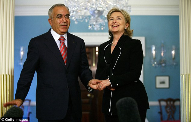Clinton had to shake with her left hand following her 2009 injury. She is pictured here with Palestinian Authority Salam Fayyad