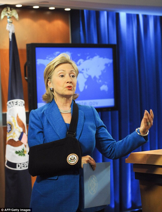 HARD KNOCKS: Clinton got a fractured elbow in 2009, but still managed to negotiate with Hondouran leaders, and, according to her spokesman, text with one hand