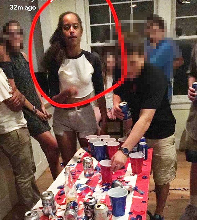 Game on: Malia Obama is seen playing pong with friends at a party on August 23 in a photo obtained exclusively by DailyMail.com (above)