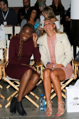 Support: Her sister Venus giggled on the front row next to fellow tennis greatCaroline Wozniacki