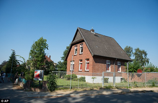 View of a house which is being used as accommodation for refugees, pictured in Reinfeld. Three Syrians have been arrested in anti-terrorism raids on Tuesday morning in the German states of Schleswig-Holstein and Lower Saxony