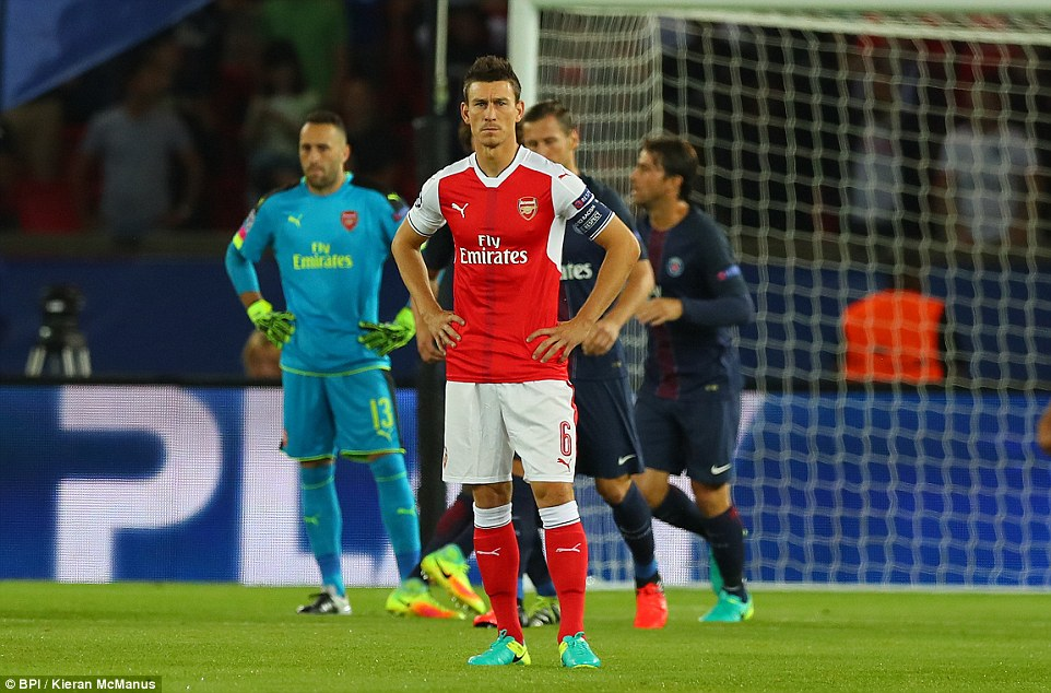 Arsenal defender Laurent Koscielny places his hands on his hips after conceding so early in the game