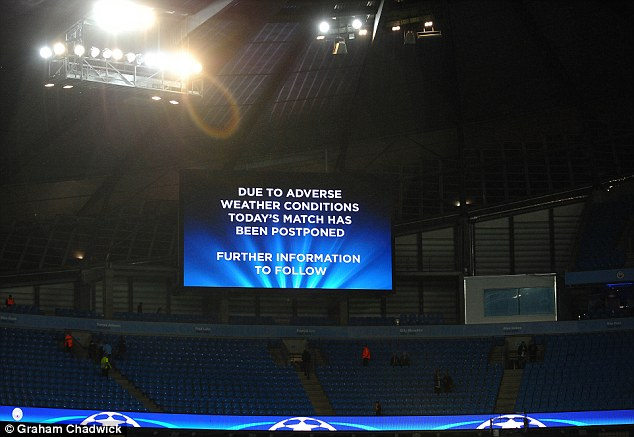 A sign at the Eithad Stadium explains that City's Champions League match has been called off